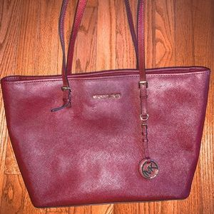 "10x16"" maroon Micheal Kors purse"